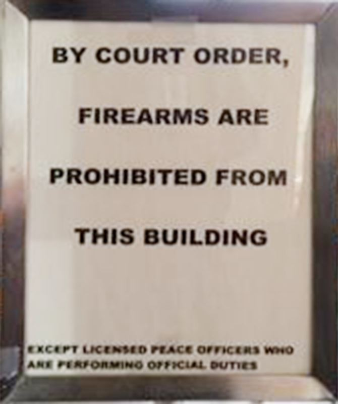 POE Sign 2 - By court order, firearms are prohibited from this building.